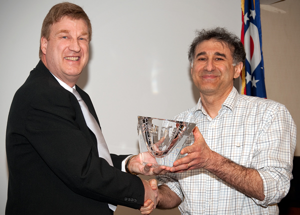 Dr. Michael Emerman (right) receives Career Award crystal from Center for Retrovirus Research Director Dr. Patrick L. Green.