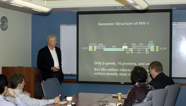 Dr. Warren C. Greene during his informal slide presentation at the Center for Retrovirus Research weekly lab meeting